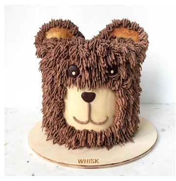 A cake shaped and decorated as a bear's head